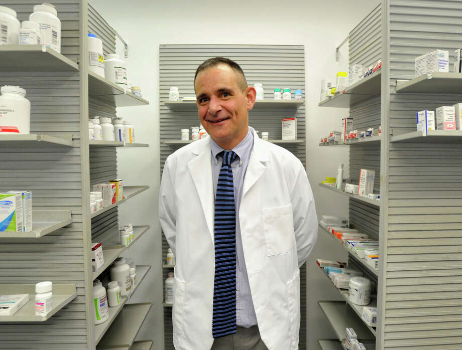 John Ciuffo is the pharmacist and owner of Cornerstone Pharmacy on Stillwater Avenue in Stamford. Photographed on Wednesday, March 20, 2013. Photo: Jason Rearick / Jason Rearick / The (Stamford) Advocate