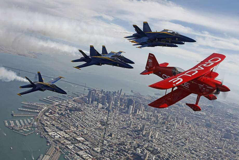 Led by Sean Tucker, an air show pilot, in a Challenger 3 aerobatic airplane sponsored by Oracle, the Blue Angels do a practice flight on Thursday afternoon, October 8, 2015 in preparation for Fleet Week 2015 over San Francisco. Photo: Brian Feulner, Brian Feulner/ San Francisco Chr