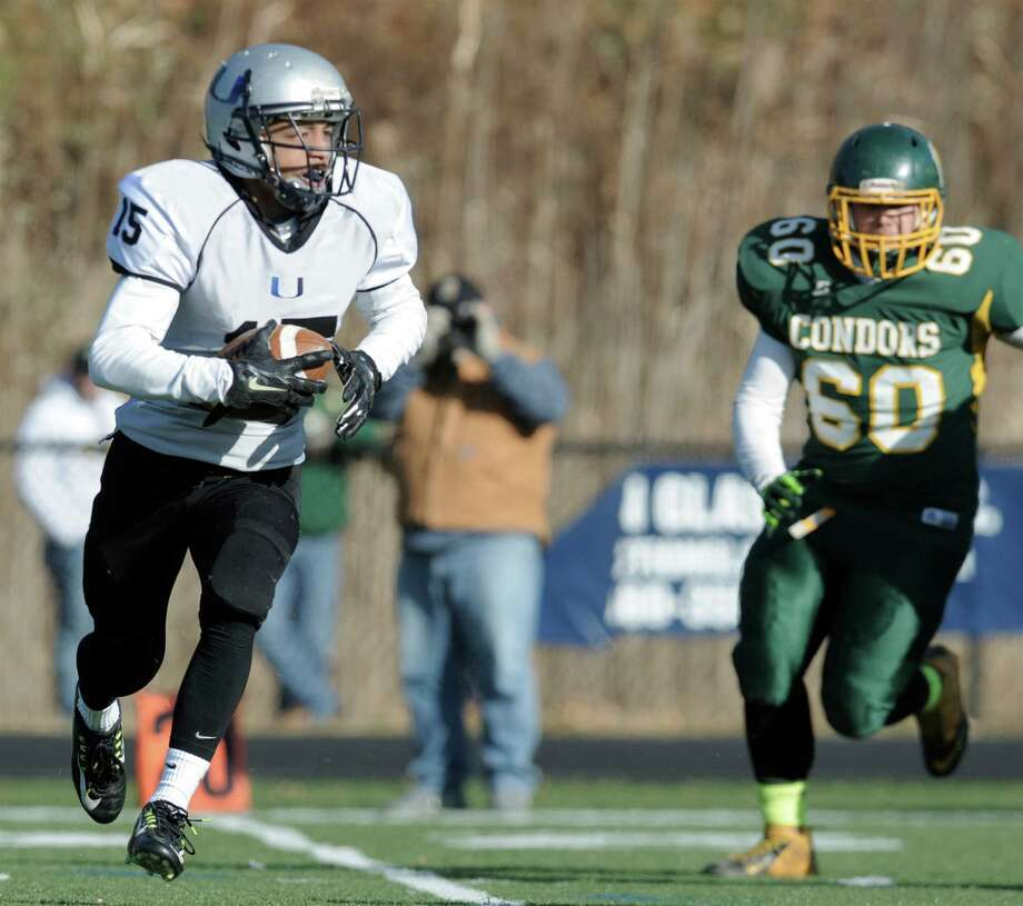 ATI United's Darius Smith (15) is pursued by O'Brien Tech's Jose Lopez (60) during the  boys football game between O'Brien Tech and Abbott Tech/Immaculate United on Saturday, November 22, 2014, played at Immaculate High School, in Danbury, Conn. Photo: H John Voorhees III / H John Voorhees III / The News-Times