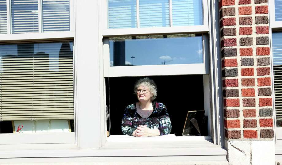 Merry Nole looks out the window of her loft at the Elder Street Artists Lofts in Houston. Photos of the Elder Street Artists Lofts in the first ward in Houston on Saturday, Jan. 1, 2000, in Houston. The lofts are celebrating their 10 years since they opened in the location of the former Jefferson Davis hospital. Photo: Elizabeth Conley, Staff / © 2015 Houston Chronicle