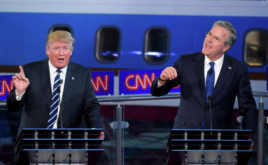 Former Florida Gov. Jeb Bush, right, and Donald Trump joust during the last GOP presidential debate. A reader asks candidates to stop bashing each other. Photo: Mark J. Terrill /Associated Press / AP