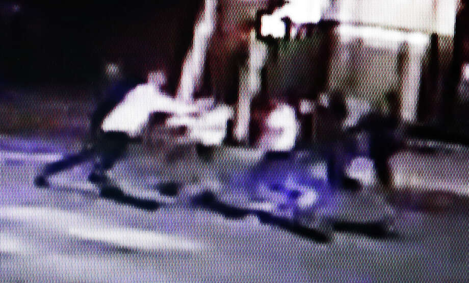 This frame from video provided by A&P Liquors, shows a group of people, including U.S. airman Spencer Stone, fighting outside a bar in Sacramento, Calif., in the early hours of Thursday, Oct. 8, 2015. Stone, who helped stop a terror attack on a French train in August, was stabbed and wounded, but is expected to survive. (A&P Liquors via AP) Photo: Associated Press / A&P Liquors