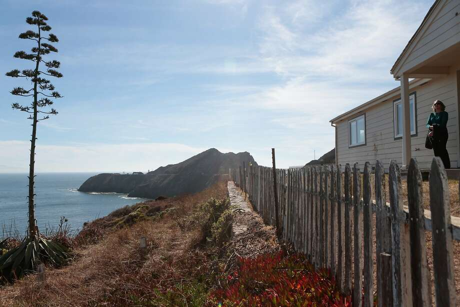 Katharine Arrow of the National Park Service stands in front of the remodeled view home in Marin County. The Park Service has made the former Coast Guard housing available for rent at market prices. Photo: Nathaniel Y. Downes, The Chronicle