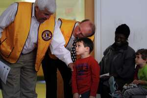 Greenwich's Lions clubs give vision screenings at St. Roch's preschool - Photo