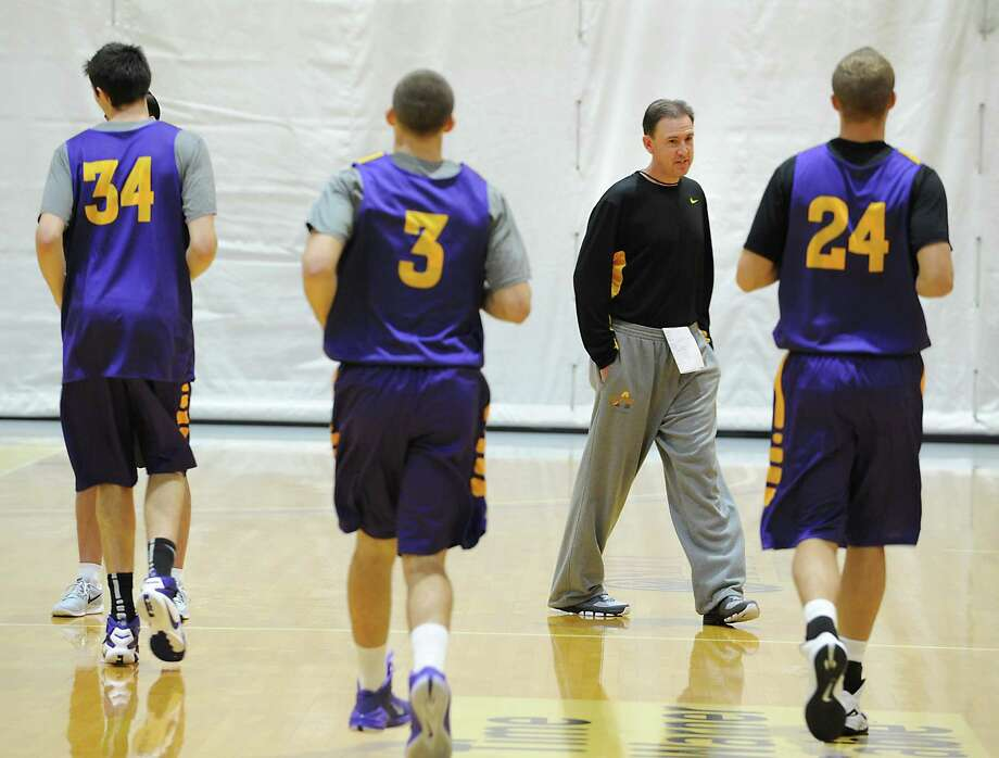 Head Coach Will Brown watches his team warm up as the University at Albany men's basketball team starts practice for the 2015-16 season at UAlbany on Thursday, Oct. 8, 2015 in Albany, N.Y. (Lori Van Buren / Times Union) Photo: Lori Van Buren / 10033674A