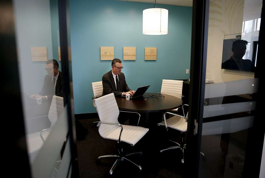 Michael McGrath, assistant vice president & private bank advisor with Umpqua Bank, uses one of the community rooms to catch up on some work at the Umpqua Bank branch on the 400 block of De Haro St. in San Francisco, Calif., on Thurs. October 8, 2015. The small offices can be reserved for use by anyone in the community. Photo: Michael Macor, The Chronicle