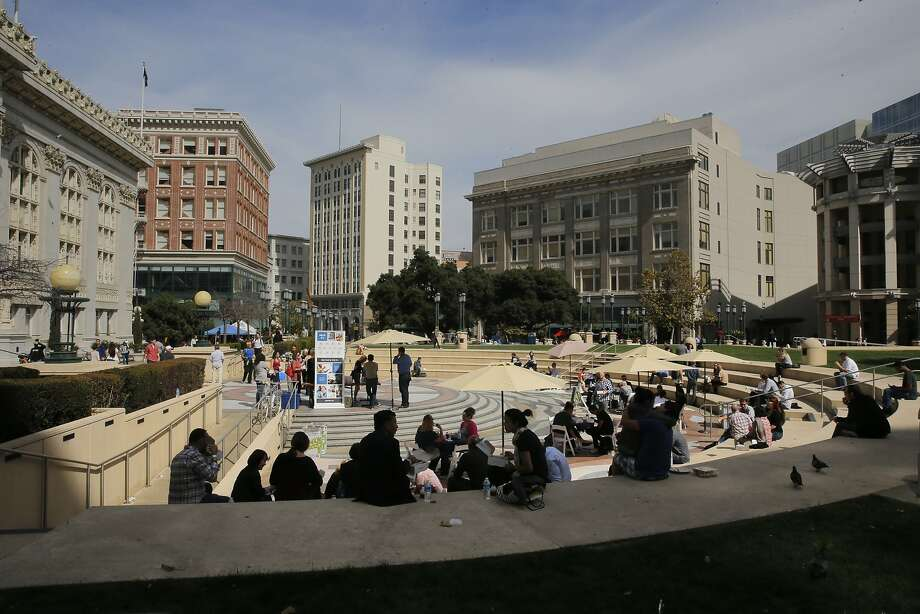 Attendees take a break for lunch during the New Co. festival at Frank Ogawa Plaza in front of city hall in Oakland, Calif., on Thurs. October 8, 2015. Photo: Michael Macor, The Chronicle
