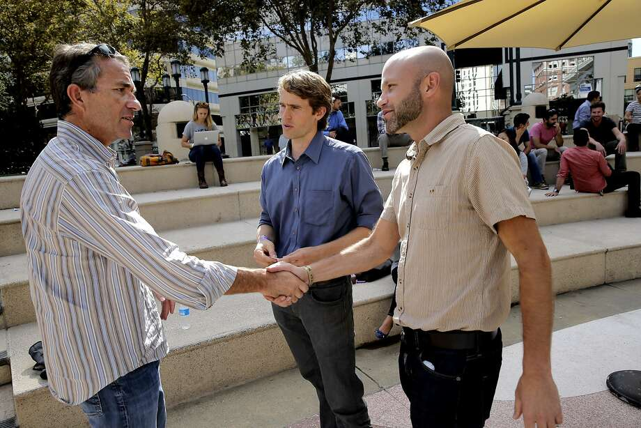NewCo co-founder John Battelle (left) greets Onno Koelman and Roni Krouzman, co-founders of the People Place, at the NewCo festival this month in Oakland. Photo: Michael Macor, The Chronicle