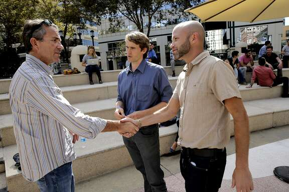 New Co. co-founder John Battelle, (left) greets Onno Koelman, (center) and Roni Krouzman co-founders of The People Place based in Oakland, Calif., during a lunch break at the New Co. festival on Thurs. October 8, 2015.