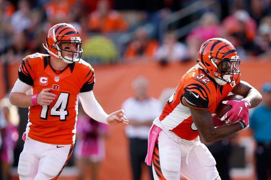 CINCINNATI, OH - Andy Dalton #14 of the Cincinnati Bengals hands the ball off to Jeremy Hill #32 during the fourth quarter of the game against the Kansas City Chiefs at Paul Brown Stadium. Cincinnati defeated Kansas City 36-21. (Photo by Joe Robbins/Getty Images)