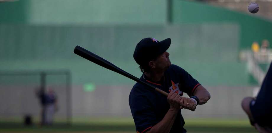 Astros bench coach Trey Hillman (22) makes sure Astros outfielders familiarize themselves with the flight of balls Thursday at Kauffman Stadium with fungoes. Photo: Karen Warren, Staff / © 2015 Houston Chronicle