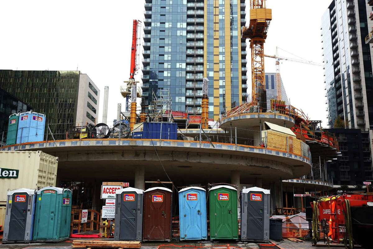 Work continues on sphere buildings at the corner of 7th Avenue and Lenora Street that will be part of Amazon's campus expansion, Thursday, October 8, 2015. Construction in Seattle is so common these days it's almost expected around every corner, and the tech industry -- with Amazon at the head of the table -- is a major driver of that growth.
