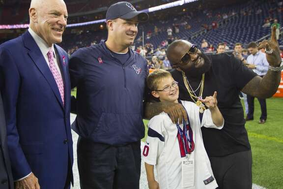 Texans owner Bob McNair, head coach Bill O'Brien and O'Brien's son, Jack, pose for a photo with Rick Ross before the Texans game against the Colts at NRG Stadium on Thursday, Oct. 8, 2015, in Houston. ( Brett Coomer / Houston Chronicle )