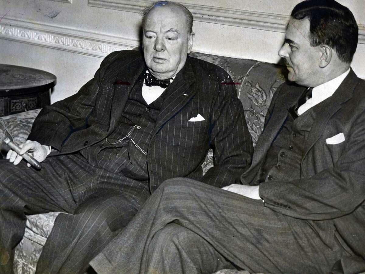 Former Prime Minister Sir Winston Churchill, left, chats with Gov. Thomas E. Dewey, right, at the Executive Mansion March 13, 1946, in Albany, N.Y. (Times Union archive)