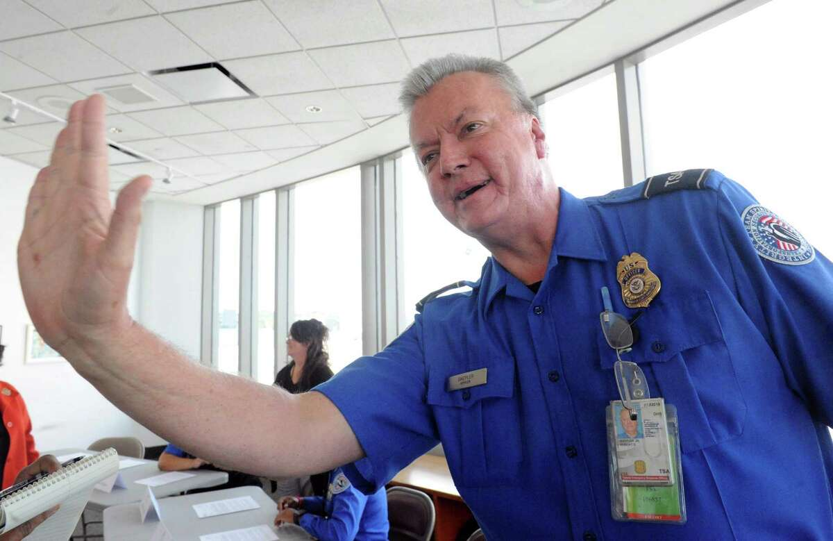 TSA officer Robert Shepler Jr. talks about seeing Pope Francis wave from his Fiat while working the Pope's September visit to Philadelphia during a press availability on Thursday Oct. 8, 2015, at Albany International Airport in Colonie, N.Y. (Michael P. Farrell/Times Union)