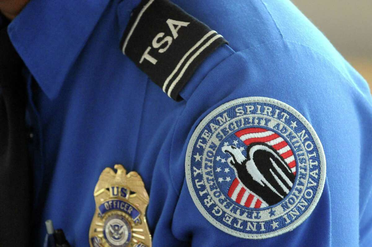 TSA officer Tahara Pleasure talks about working the Pope's September visit to Philadelphia during a press availability on Thursday Oct. 8, 2015, at Albany International Airport in Colonie, N.Y. (Michael P. Farrell/Times Union)