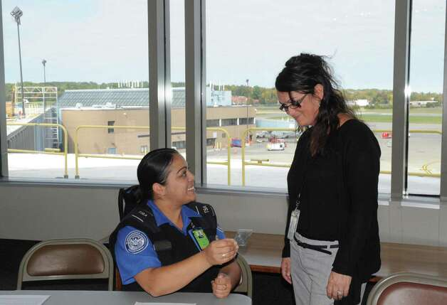 TSA officer Brenda DeJesus, left, and manager Ruth Germani talk about working the Pope's September visit to Philadelphia during a press availability on Thursday Oct. 8, 2015, at Albany International Airport in Colonie, N.Y.  (Michael P. Farrell/Times Union) Photo: Michael P. Farrell / 10033687A