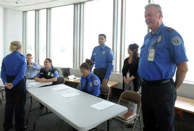 TSA officer Robert Shepler Jr., right, talks about working the Pope's September visit to Philadelphia during a press availability on Thursday Oct. 8, 2015, at Albany International Airport in Colonie, N.Y.  (Michael P. Farrell/Times Union) Photo: Michael P. Farrell / 10033687A