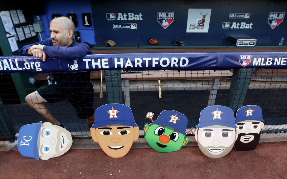 Faces of the game surround Astros clubhouse attendant Stacy Gallagher as he awaits Thursday's ALDS opener at Kauffman Stadium. Photo: Karen Warren, Staff / © 2015 Houston Chronicle