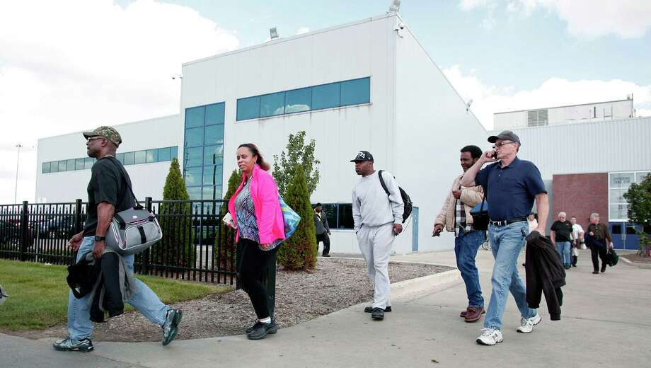 Fiat Chrysler workers leave a truck assembly plant at the end of their shift this week in Warren, Mich.  Photo: Bill Pugliano, Stringer / 2015 Getty Images