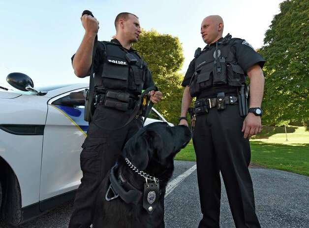 Patrolman Nick Colaneri, right, with partner Cory Wagner and his partner K-9 Mick near Main Street Tuesday morning, Oct. 6, 2015, in Hoosick Falls, N.Y. (Skip Dickstein/Times Union) Photo: SKIP DICKSTEIN / 10033623A