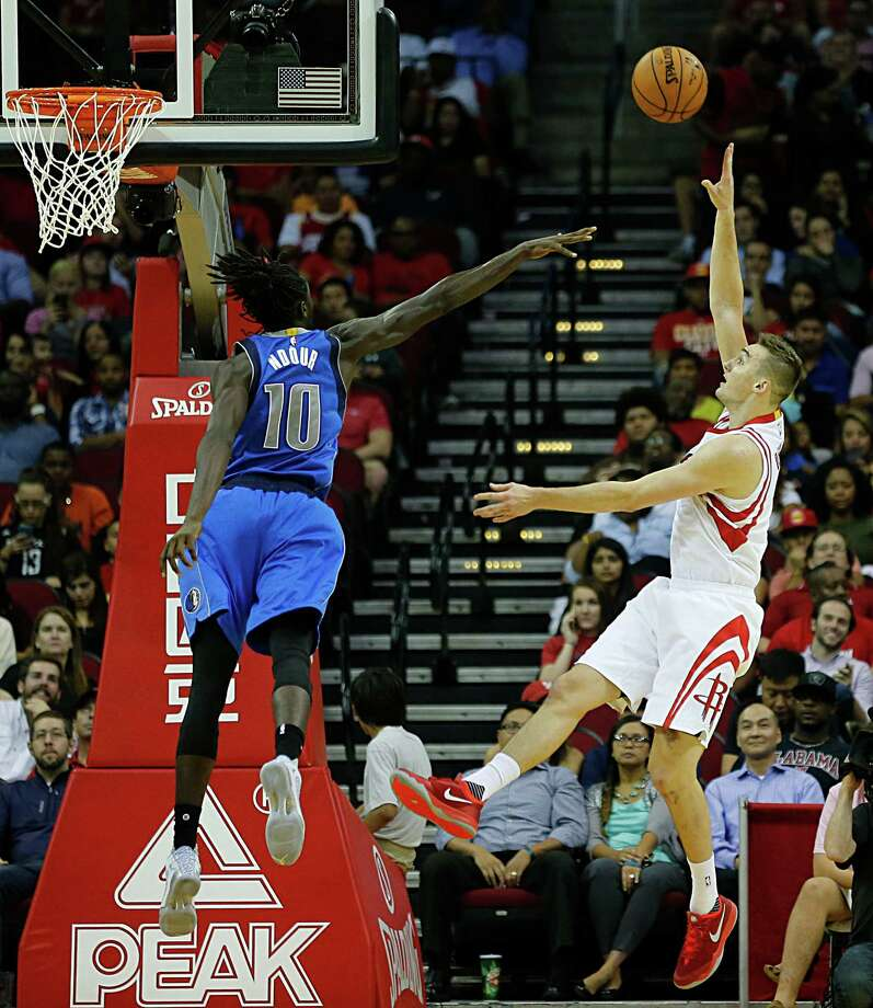 Houston Rockets forward Sam Dekker right, shoots over Dallas Mavericks forward Maurice Daly Ndour during second half NBA preseason game action at the Toyota Center Wednesday, Oct. 7, 2015, in Houston.  ( James Nielsen / Houston Chronicle ) Photo: James Nielsen, Staff / © 2015  Houston Chronicle