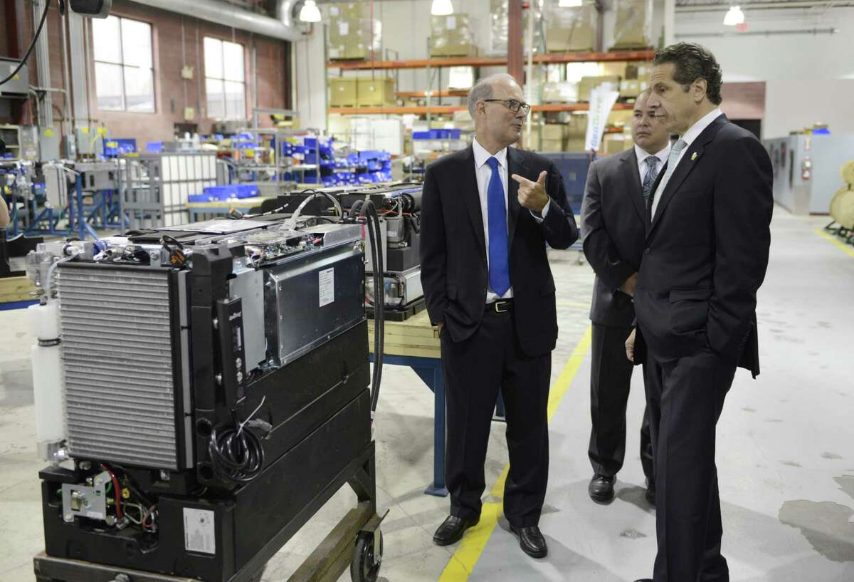 Plug Power CEO Andy Marsh, left, gives Gov. Andrew Cuomo a factory tour Wednesday, Oct. 8, 2014, at Plug Power in Colonie, N.Y., where the governor was endorsed by the state Business Council. (Will Waldron/Times Union)
