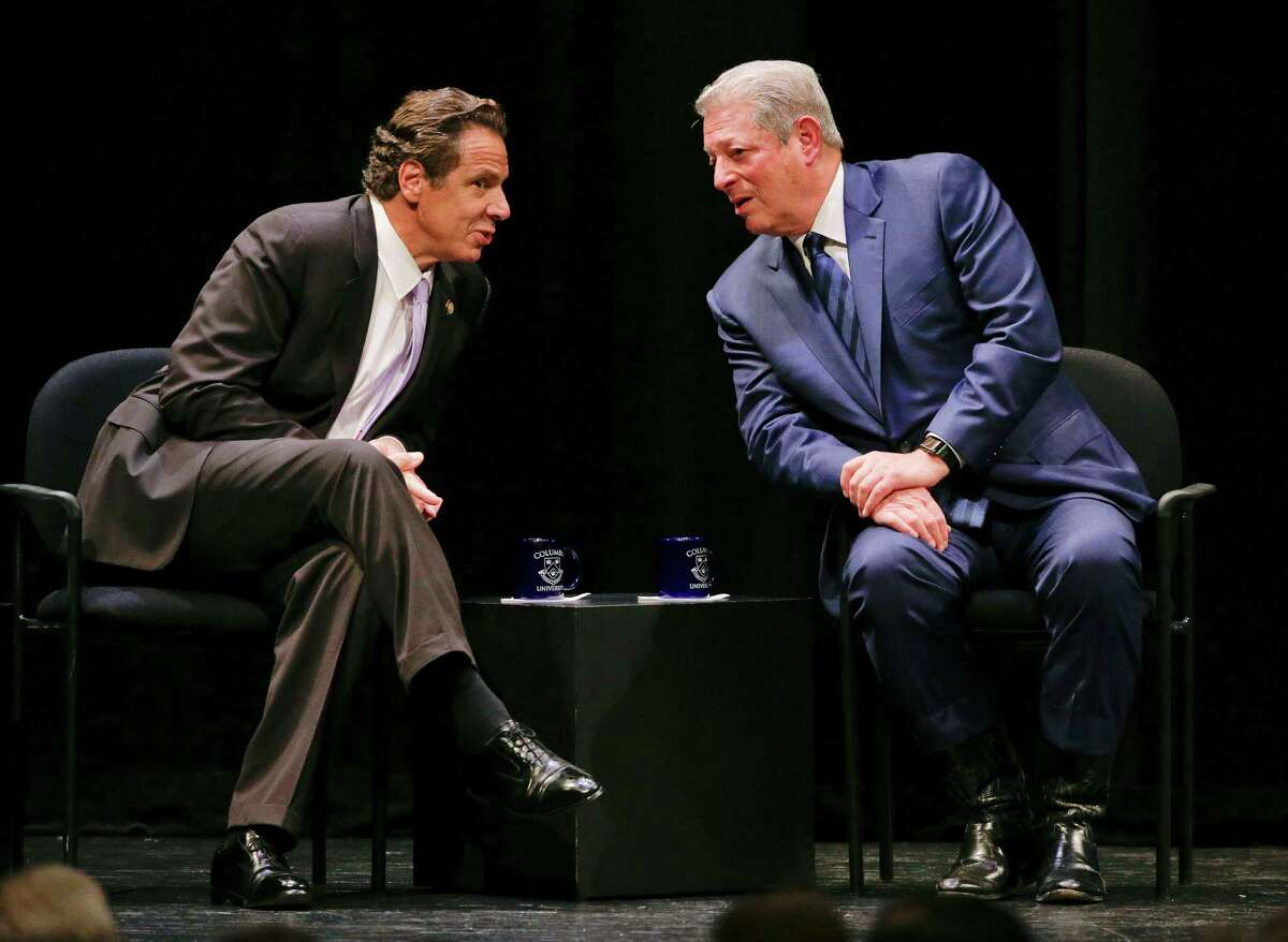 New York Governor Andrew Cuomo, left, talks with former Vice President Al Gore before making an announcement, Thursday, Oct. 8, 2015, in New York. Cuomo announced that the state of New York was signing a memorandum of understanding to join 42 other governments in trying to keep the planet's temperature from rising another 2 degrees Celsius. (AP Photo/Julie Jacobson) ORG XMIT: NYJJ101