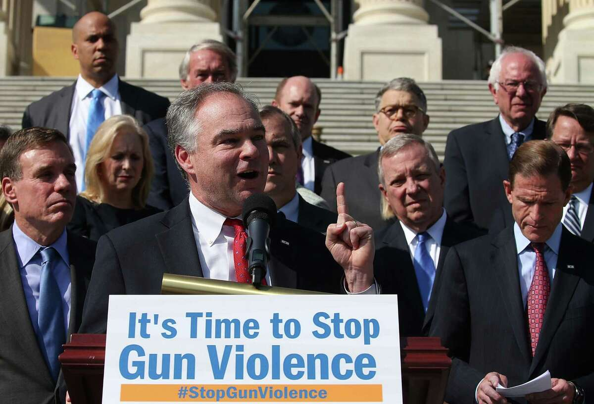 WASHINGTON, DC - OCTOBER 08: Sen. Sen. Tim Kaine (D-VA) is flanked by Senate colleagues while speaking about gun control during a news conference on the Senate steps at the US Capitol, October 8, 2015 in Washington, DC.ÊSenate DemocratsÊunveiled their principles for new gun safety legislation and announced a major public outreach effort to galvanize the country to encourage Congress to pass new legislation. (Photo by Mark Wilson/Getty Images) ORG XMIT: 584030393