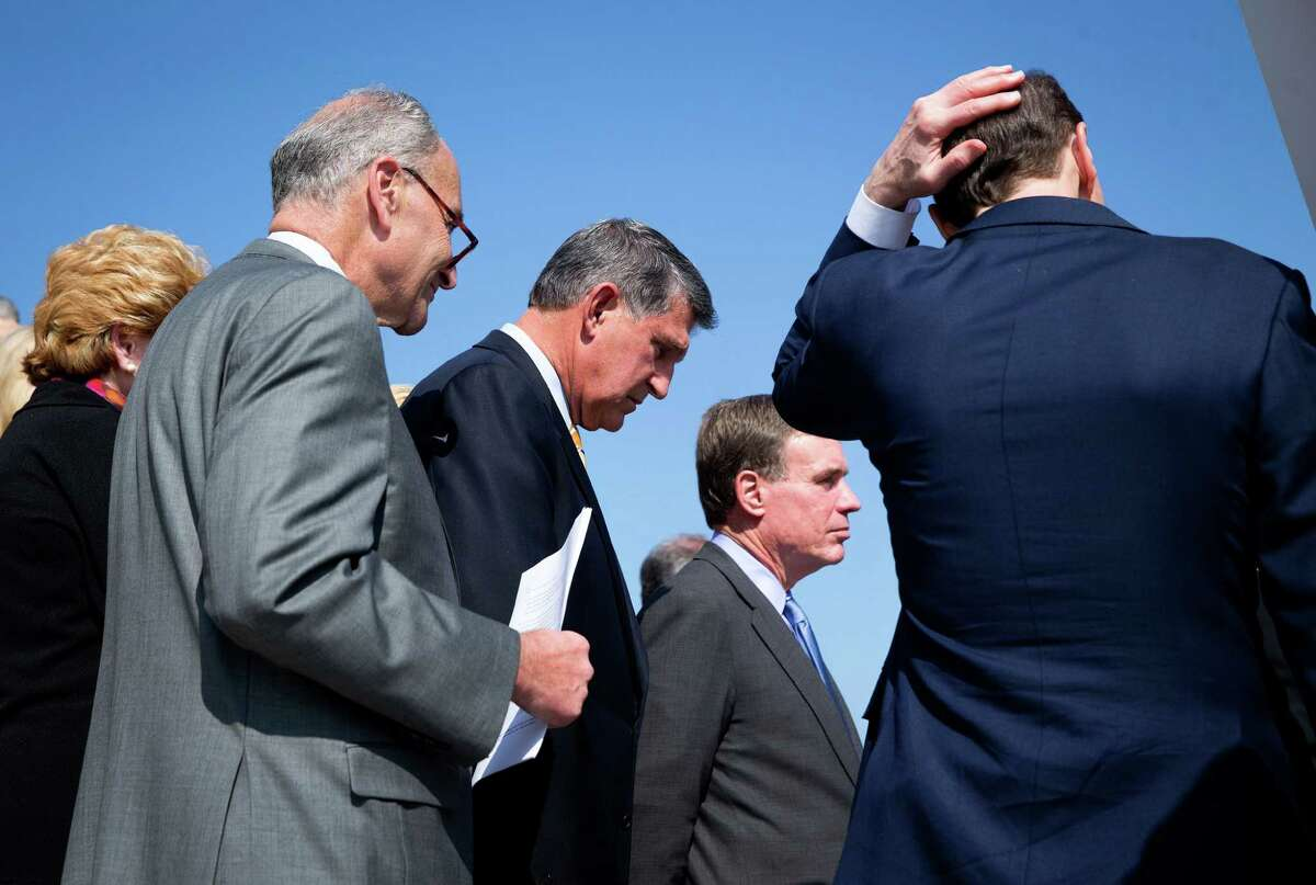 From left: Sens. Chuck Schumer (D-N.Y.) Joe Manchin (D-W.V.) and Mark Warner (D-Va) and other Senate Democrats hold a news conference to discuss gun safety legislation on the steps of the Capitol in Washington, Oct. 8, 2015. (Doug Mills/The New York Times) ORG XMIT: XNYT97