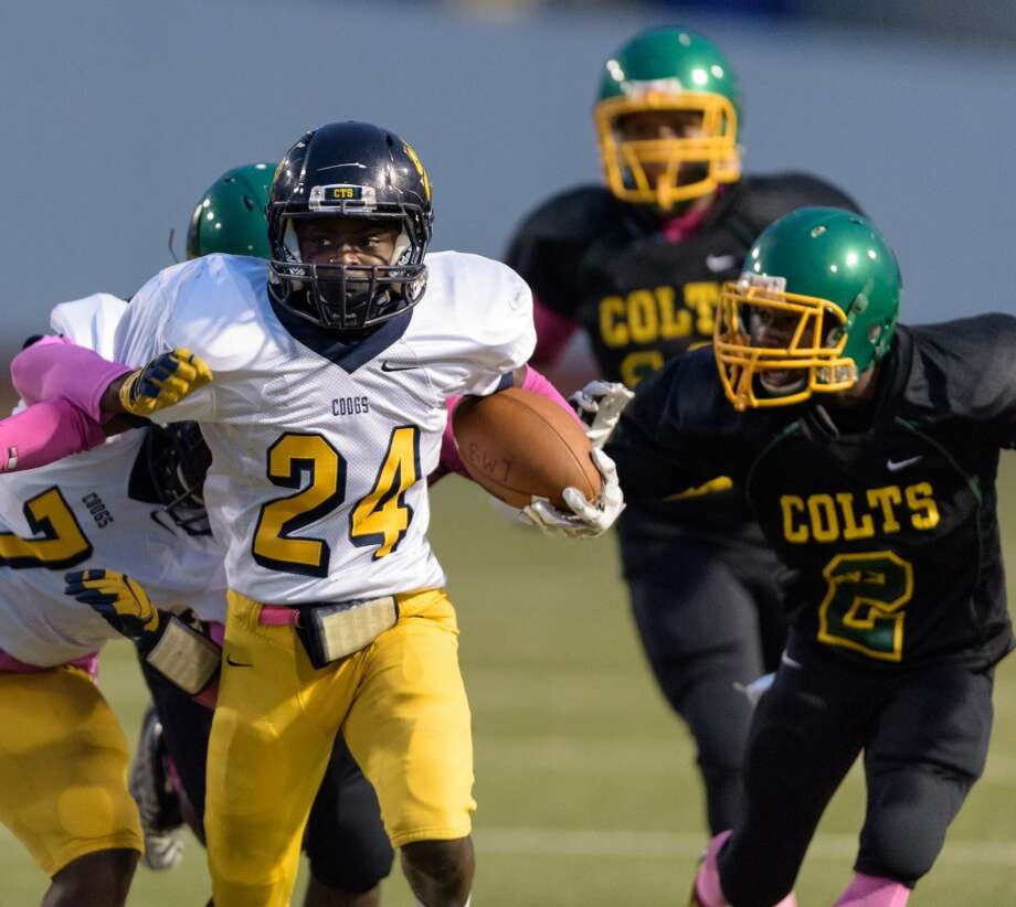 La Marque 62, Worthing 20Daquan Jones (24) of the La Marque Cougars runs up the middle against the Worthing Colts in the first half in a high school football game on Thursday, October 8, 2015 at Barnett Stadium. Photo: Wilf Thorne, For The Chronicle