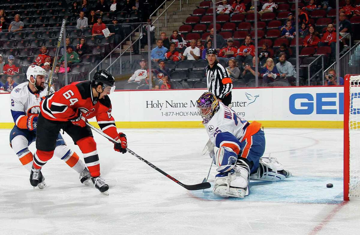 NEWARK, NJ - SEPTEMBER 25: Joseph Blandisi #64 of the New Jersey Devils scores a shorthanded goal at 5:58 of the second period against Stephon Williams #35 of the New York Islanders at the Prudential Center on September 25, 2015 in Newark, New Jersey. (Photo by Bruce Bennett/Getty Images) ORG XMIT: 573904049