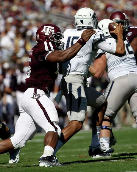 Texas A&M defensive end Myles Garrett, left, is tops in the SEC and third in the nation with 71/2 sacks. Photo: David J. Phillip, STF / AP