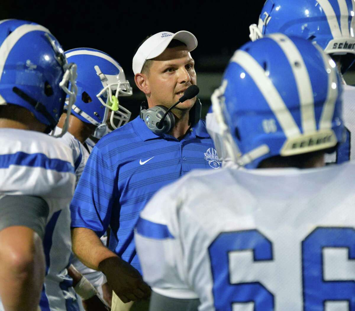 Shaker head coach Greg Sheeler with players during a time out in Saturday night's game against Shenendehowa High Sept. 11, 2015 in Clifton Park, NY. (John Carl D'Annibale / Times Union)