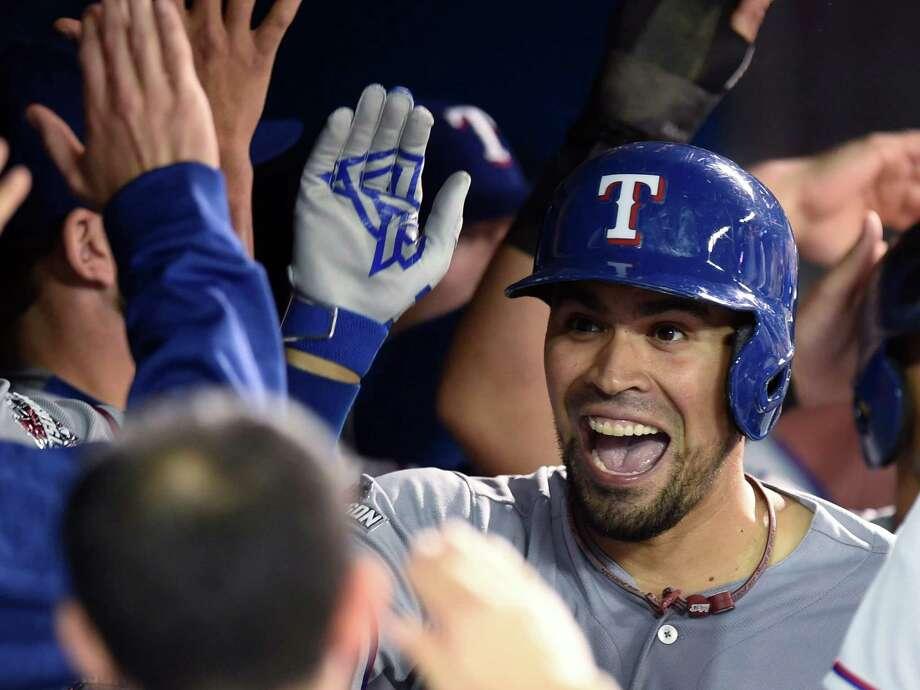 Catcher Robinson Chirinos brightens the Rangers' dugout Thursday after hitting a two-run, fifth-inning homer off David Price to give Texas a 4-1 lead Photo: Frank Gunn, SUB / The Canadian Press