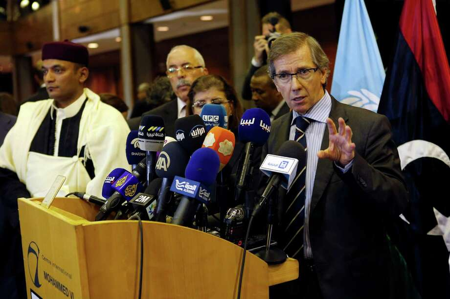 United Nations envoy for Libya Bernardino Leon, right, gestures as he makes an announcement to the media in Skhirat, Morocco, Thursday, Oct. 8, 2015. The U.N. envoy for Libya has announced a national unity government for Libya after months of difficult talks between the north African country's two rival governments. (AP Photo/Abdeljalil Bounhar) Photo: Abdeljalil Bounhar, STR / AP