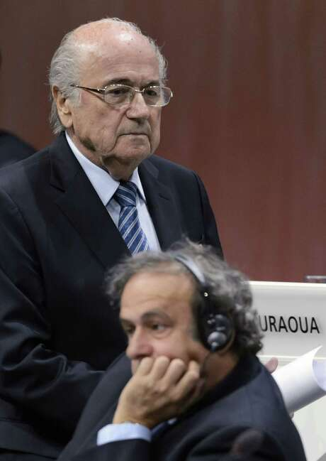 FILES - A file picture taken on May 29, 2015 shows FIFA President Sepp Blatter (top) walking behind UEFA President Michel Platini during the 65th FIFA Congress in Zurich. Scandal-tainted FIFA's ethics watchdog was locked in talks on October 7, 2015 to decide the fate of world football president Sepp Blatter as attacks on the veteran sports baron mounted. The ethics committee tribunal was also to decide whether to take action against UEFA leader Michael Platini and former FIFA vice president Chung Mong-Joon, both candidates to take over from Blatter. AFP PHOTO / FABRICE COFFRINIFABRICE COFFRINI/AFP/Getty Images Photo: FABRICE COFFRINI, Stringer / AFP