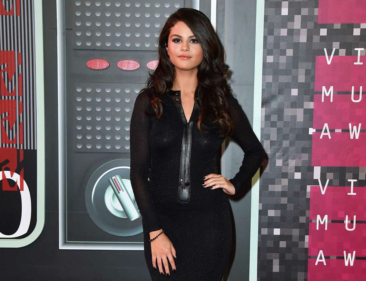 FILE - In this Aug. 30, 2015 file photo, Selena Gomez arrives at the MTV Video Music Awards in Los Angeles. Gomez has revealed that she?'s battling the debilitating immune system disorder lupus. ?