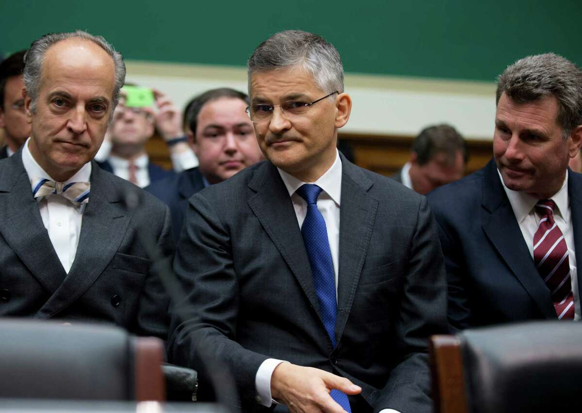 Volkswagen of America CEO Michael Horn, center, waits to testify on Capitol Hill in Washington, Thursday, Oct. 8, 2015, before the House Oversight and Investigations subcommittee hearing on Volkswagen's emissions-rigging scandal. (AP Photo/Manuel Balce Ceneta) ORG XMIT: DCMC103