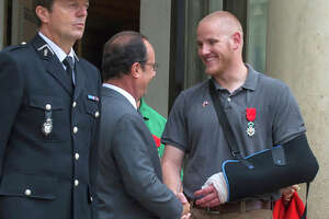 Train attack hero stabbed - Photo