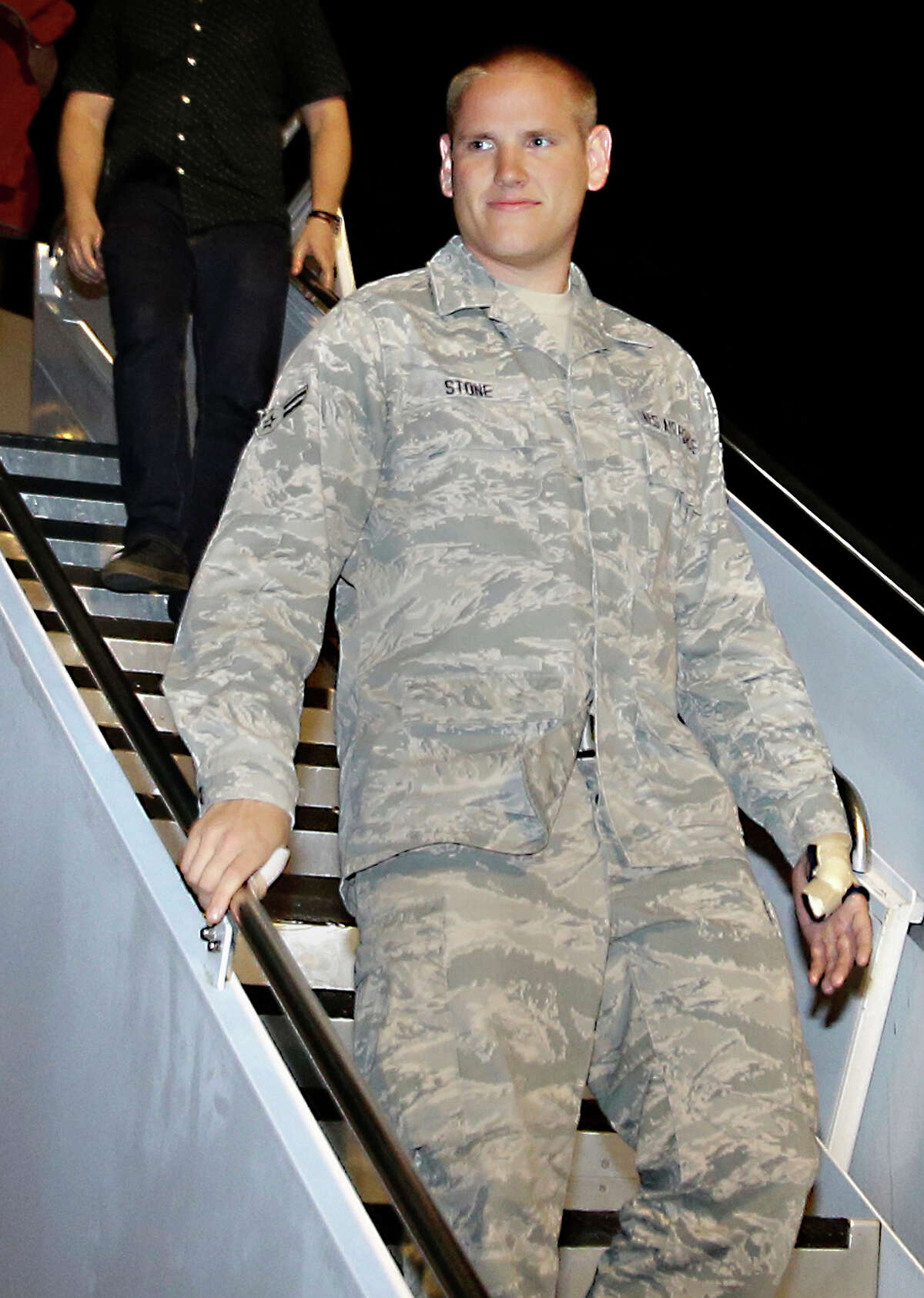 FILE - In this Sept. 3, 2015 file photo, U.S. Air Force Airman 1st Class Spencer Stone, one of three Americans who tackled a heavily armed gunman on a Paris-bound train on Aug. 21, arrives at Travis Air Force Base in Fairfield, Calif. Stone is in stable condition Thursday, Oct. 8, 2015, after being stabbed in Sacramento, Calif., according to an Air Force spokesman. (AP Photo/Rich Pedroncelli, File) ORG XMIT: NY111