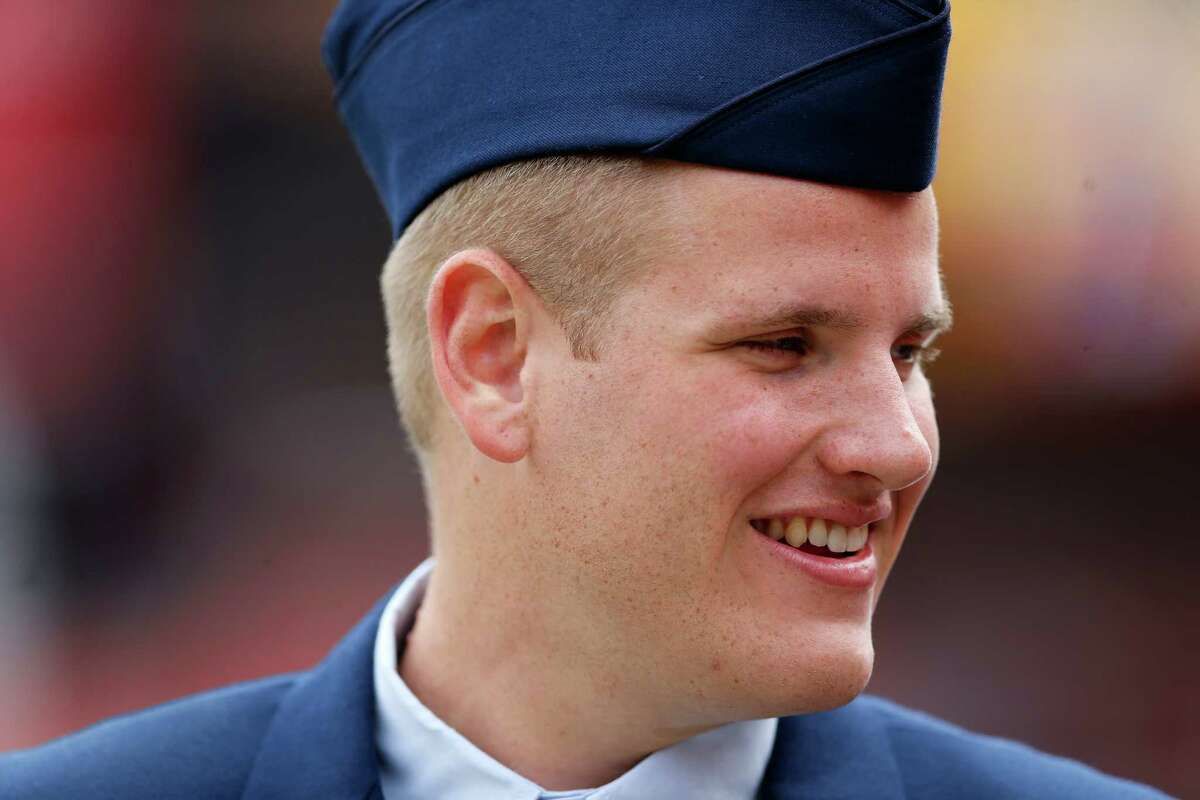 FILE - In this Sept. 20, 2015 file photo, US Air Force Airman 1st Class Spencer Stone walks along the sidelines before an NFL football game in Landover, Md. An Air Force spokesman said Thursday, Oct. 8, 2015, that Stone, who helped subdue an attacker on a Paris-bound train in August, is in stable condition after being stabbed in California. (AP Photo/Patrick Semansky, File) ORG XMIT: LA101