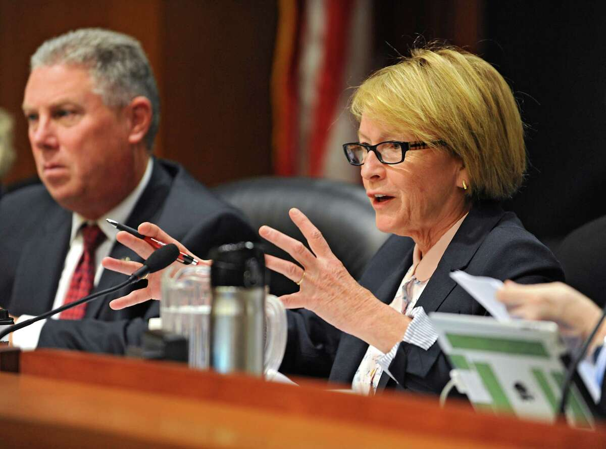 Assembly member Aileen Gunther speaks to Mark Kissinger, director, division of long term care, NYS Department of Health during a hearing on services and medical care for those with traumatic brain injury on Thursday, Oct. 8, 2015 at the Legislative Office Building in Albany, N.Y. Assembly member John McDonald sits at left. (Lori Van Buren / Times Union)