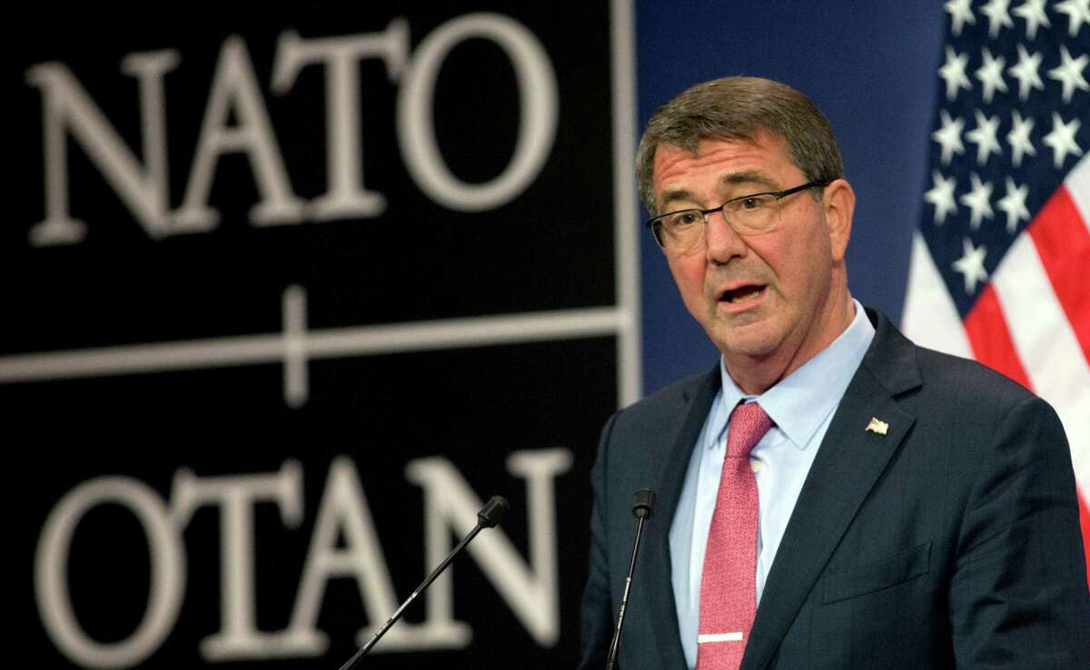 U.S. Secretary of Defense Ash Carter speaks during a media conference after a meeting of NATO defense ministers at NATO headquarters in Brussels on Thursday, Oct. 8, 2015. NATO defense ministers met Thursday to consider the implications of recent Russian military actions in Syria, as well as ongoing measures to retool NATO to meet contemporary security threats. (AP Photo/Virginia Mayo) ORG XMIT: VLM151