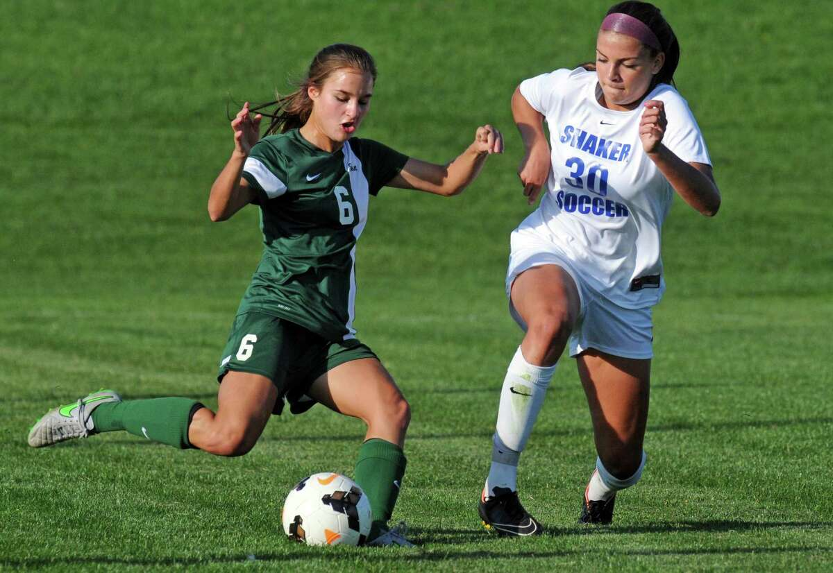Shen's Melissa Haas and Shaker's Brooke Clough get position on the ball during their girl's high school soccer game on Thursday Oct. 8, 2015 in Colonie , N.Y. (Michael P. Farrell/Times Union)