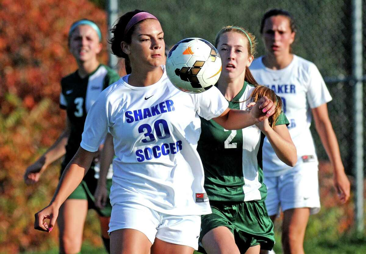 Shaker's Brooke Clough and Shen's Mia Longo get position on the ball during their girl's high school soccer game on Thursday Oct. 8, 2015 in Colonie , N.Y. (Michael P. Farrell/Times Union)