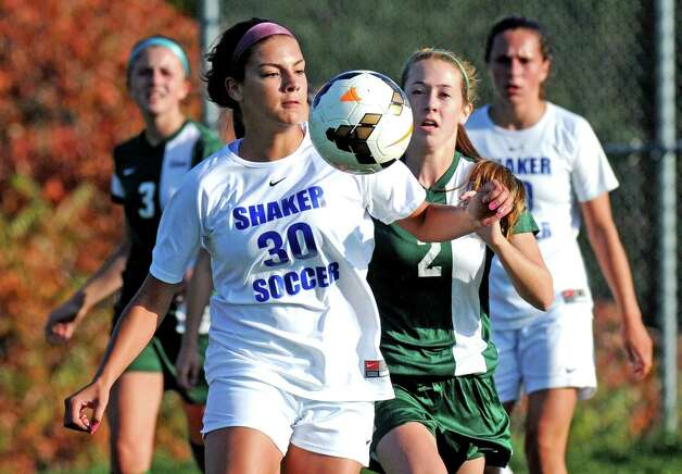 Shaker's Brooke Clough and Shen's Mia Longo get position on the ball during their girl's high school soccer game on Thursday Oct. 8, 2015 in Colonie , N.Y.  (Michael P. Farrell/Times Union) Photo: Michael P. Farrell / 10033661A