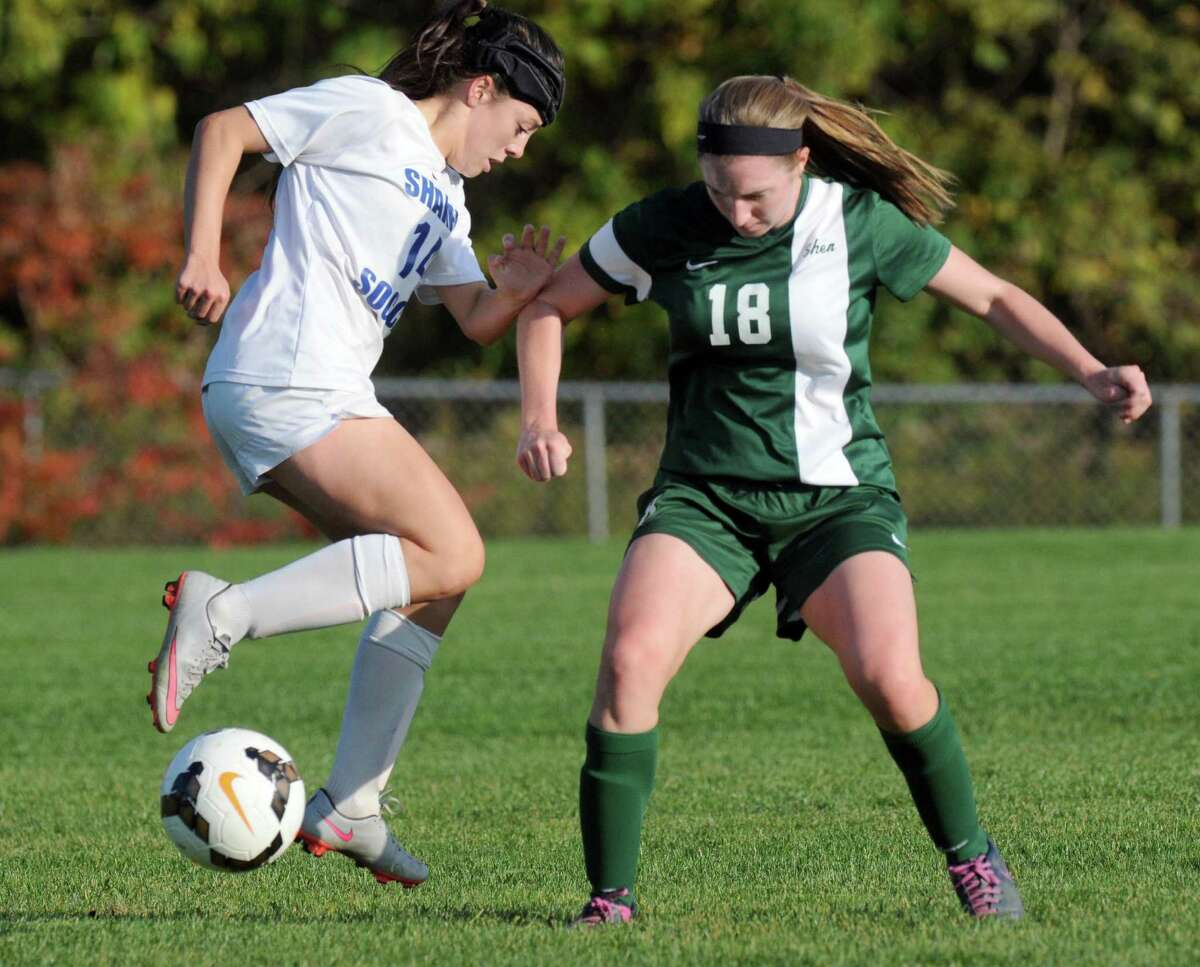 Shaker's Erin Valente and Shen's Meghan Pendergast get position on the ball during their girl's high school soccer game on Thursday Oct. 8, 2015 in Colonie , N.Y. (Michael P. Farrell/Times Union)