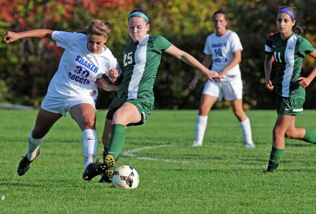 Shaker's Brooke Clough and Shen's Meghan Cavanaugh get position on the ball during their girl's high school soccer game on Thursday Oct. 8, 2015 in Colonie , N.Y.  (Michael P. Farrell/Times Union) Photo: Michael P. Farrell / 10033661A