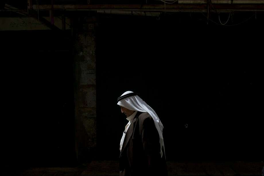 A Palestinian man walks in the Old City in Jerusalem, Thursday, Oct. 8, 2015. A Palestinian stabbed a Jewish seminary student in Jerusalem on Thursday as the Israeli prime minister barred all Cabinet ministers and lawmakers from visiting a sensitive holy site in the Old City in an effort to calm tensions that have gripped the country for weeks. Photo: Sebastian Scheiner, Associated Press